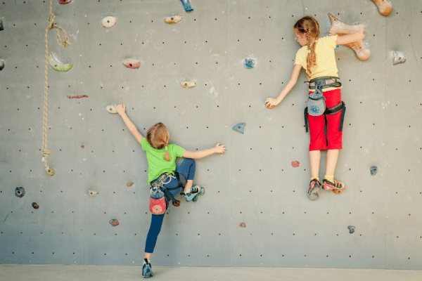 Children climbing indoor wall