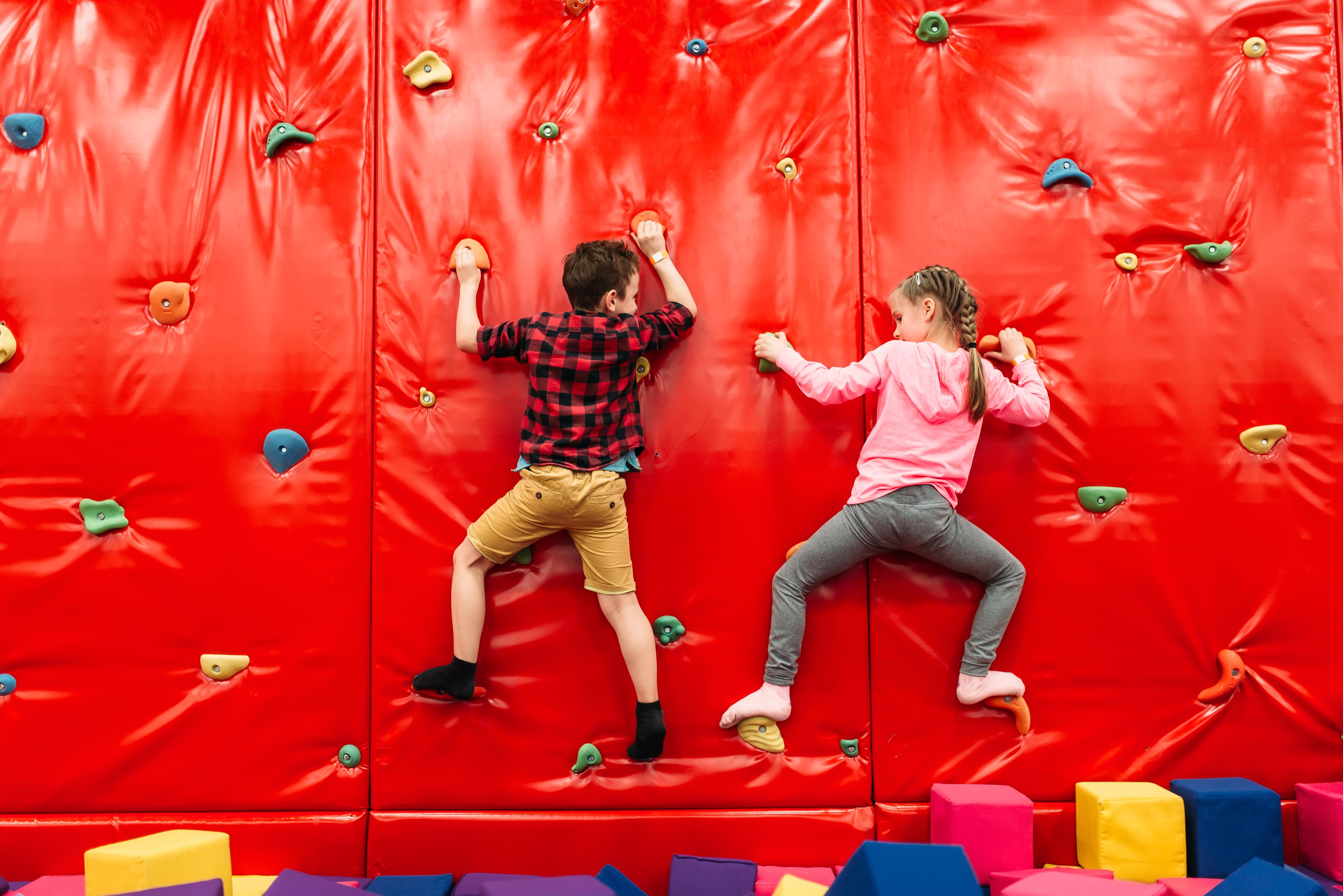 children climbing on a soft play climbing wall